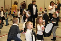 students taking part in penguin hop