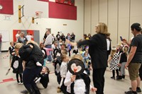 wide shot of gym during penguin hop 1