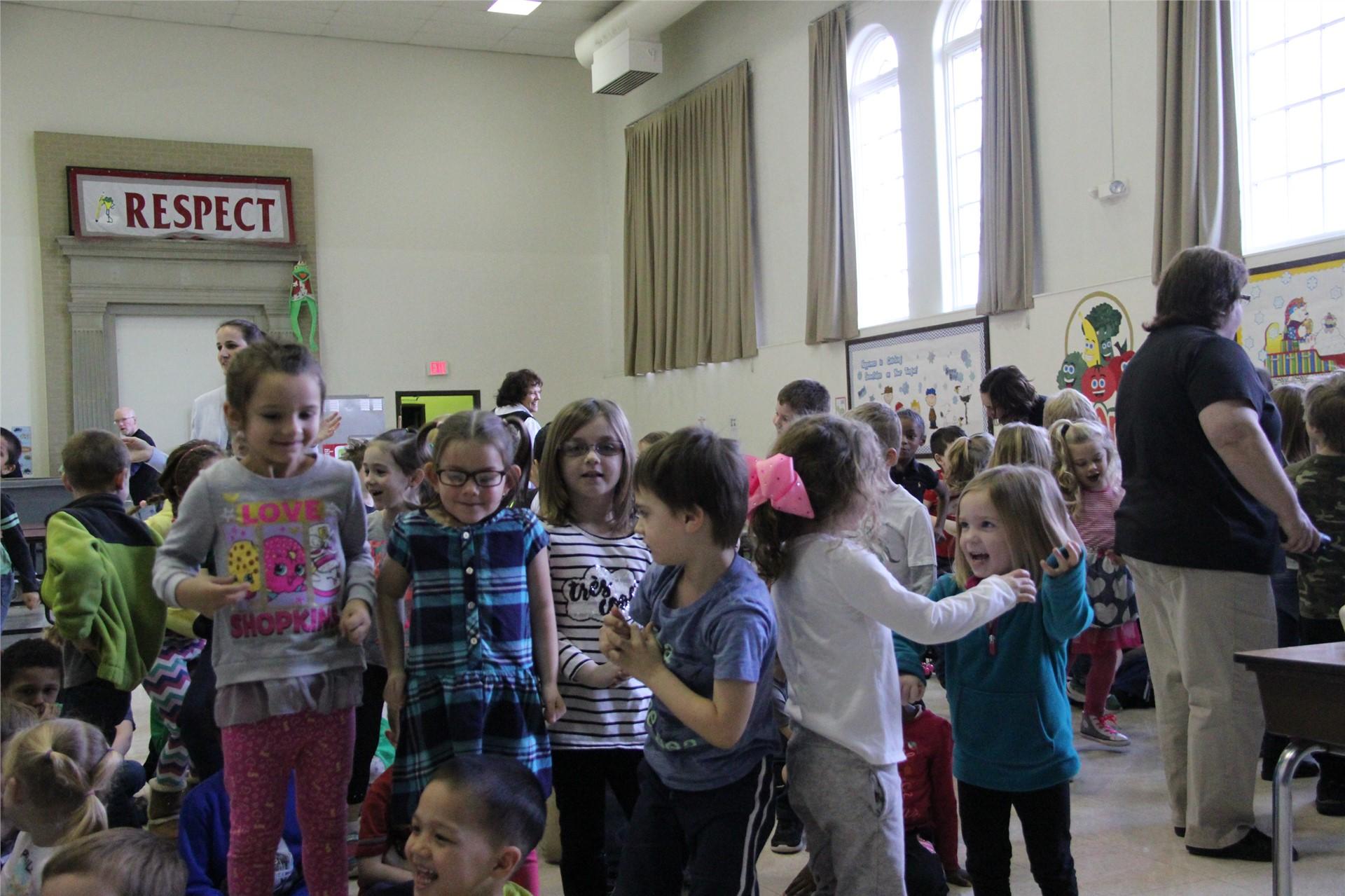 wide shot of students dancing