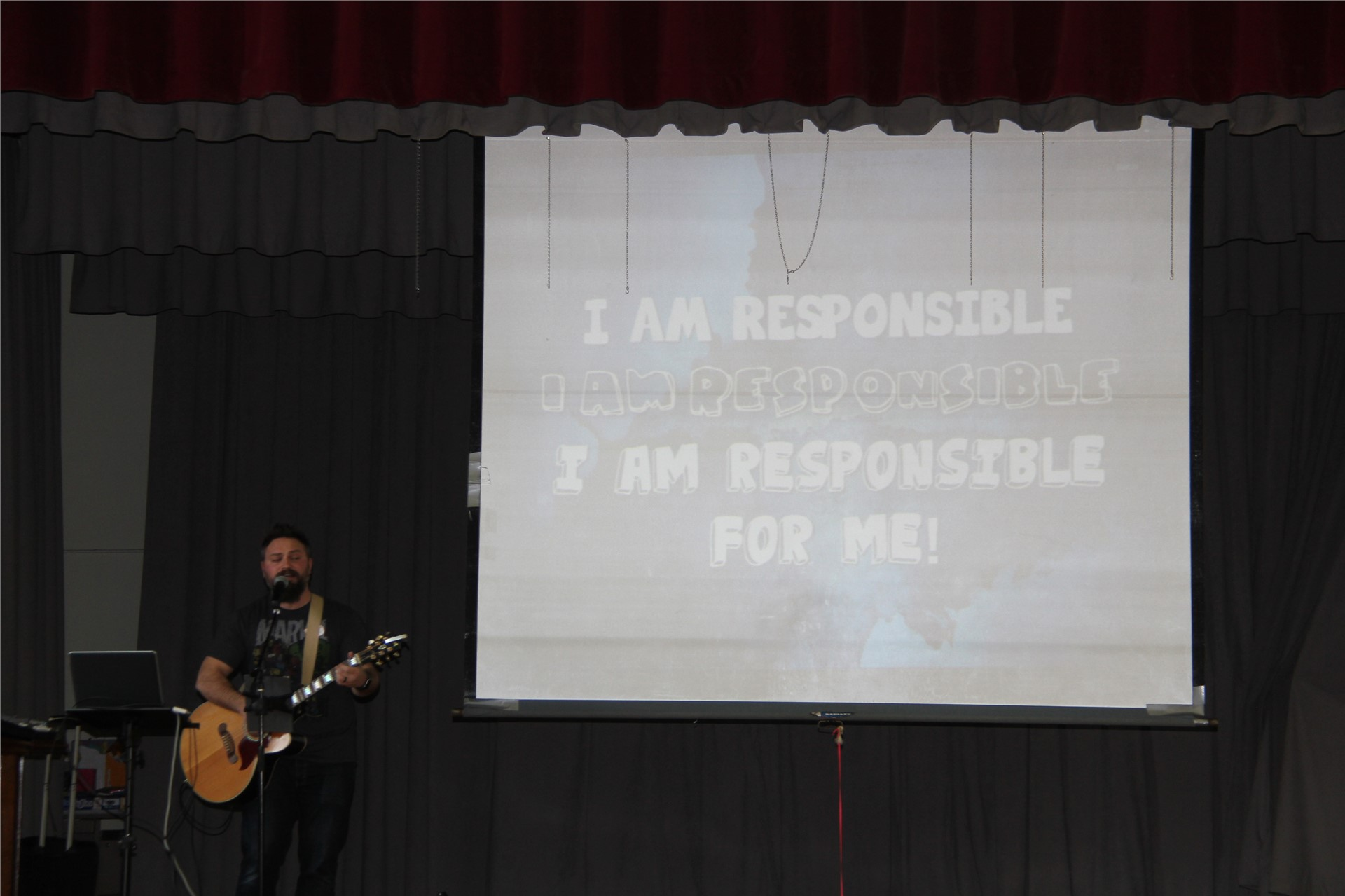 jared campbell peforming in front of powerpoint projection