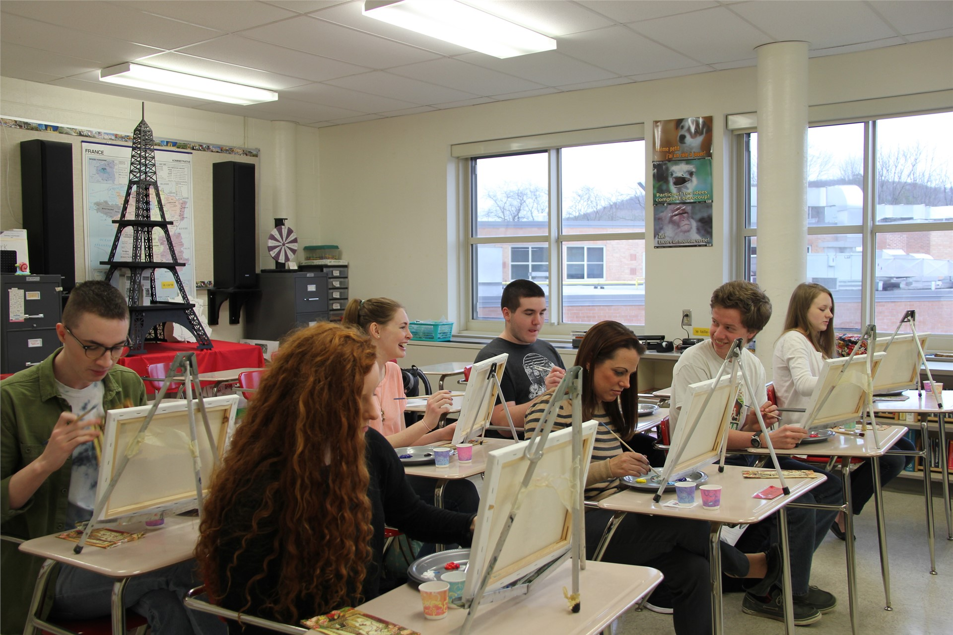 students painting at desks