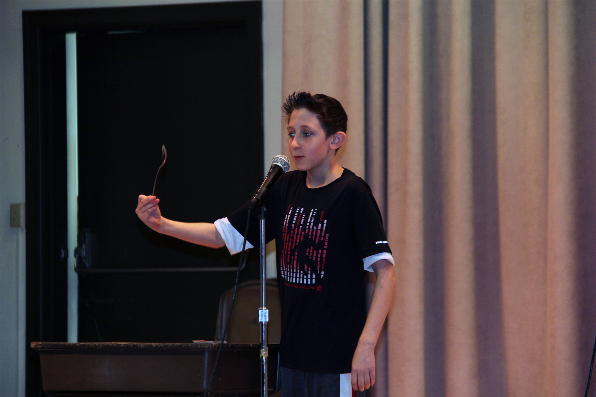 student talking into microphone