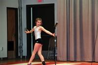 student standing on gymnastics mat