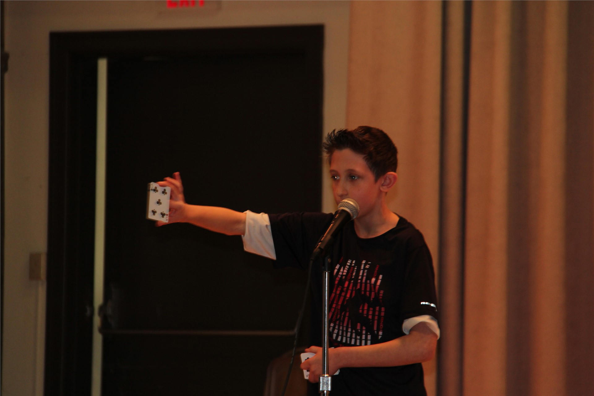 student on stage with card in hand