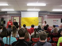 wide shot of students talking in front of other students