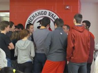 group of students standing and talking