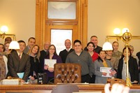 group of people standing in front of courtroom some holding certificates