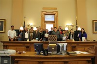 group of people standing in front of court room