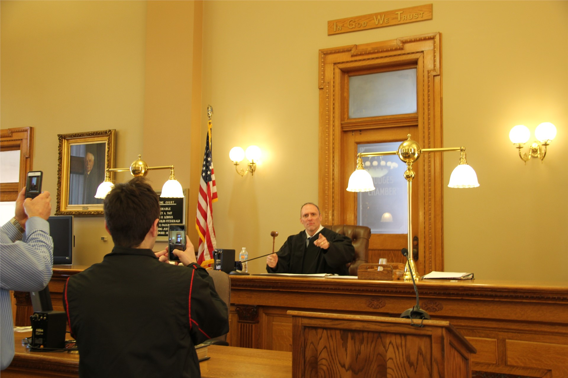 wide shot of teacher sitting at judges seat