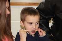 student taste testing frosting