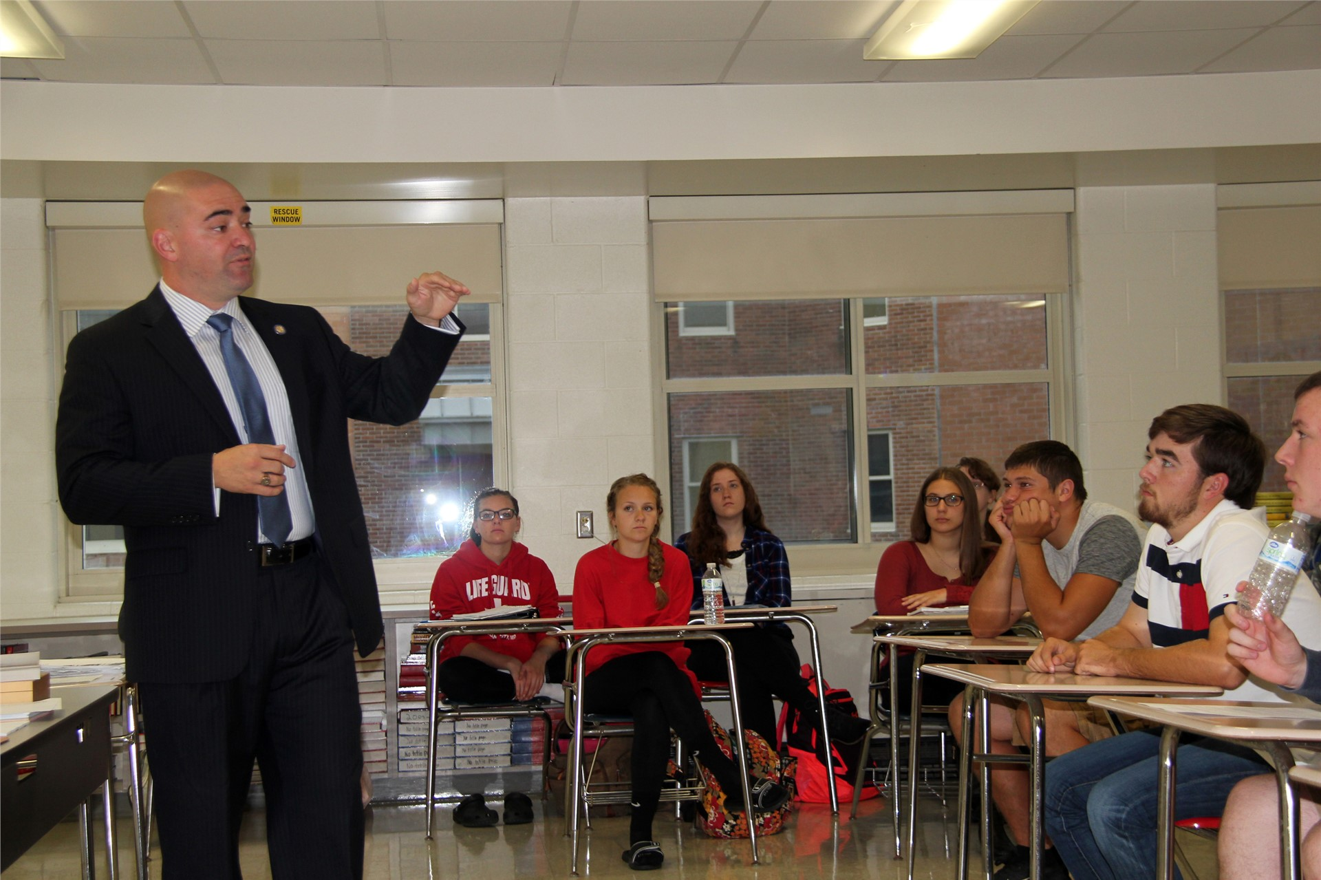 senator akshar talking to students in classroom