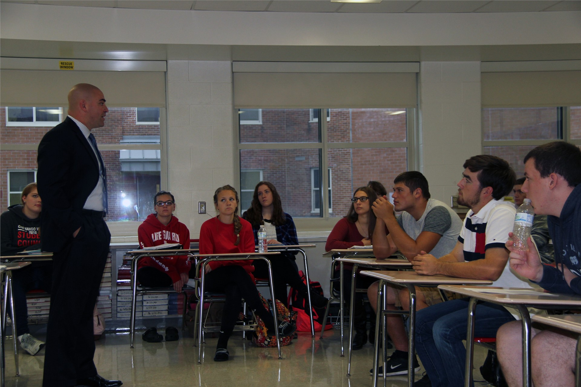 senator akshar standing talking to students