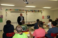 wide shot of senator akshar talking to students