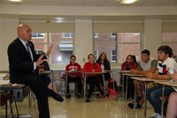 senator akshar talking in classroom to students
