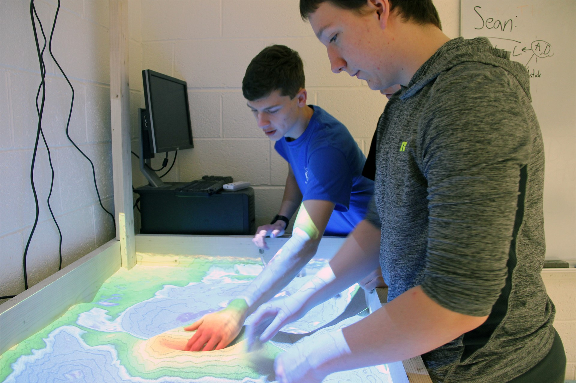 students looking at augmented reality map