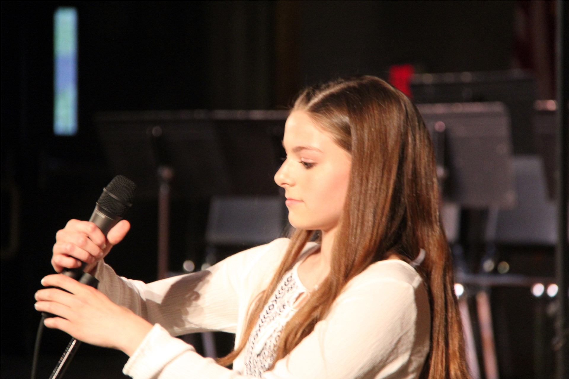 student holding microphone