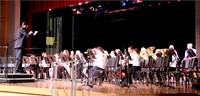 teacher conducts band performance