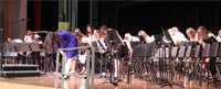 teacher and students bowing on stage