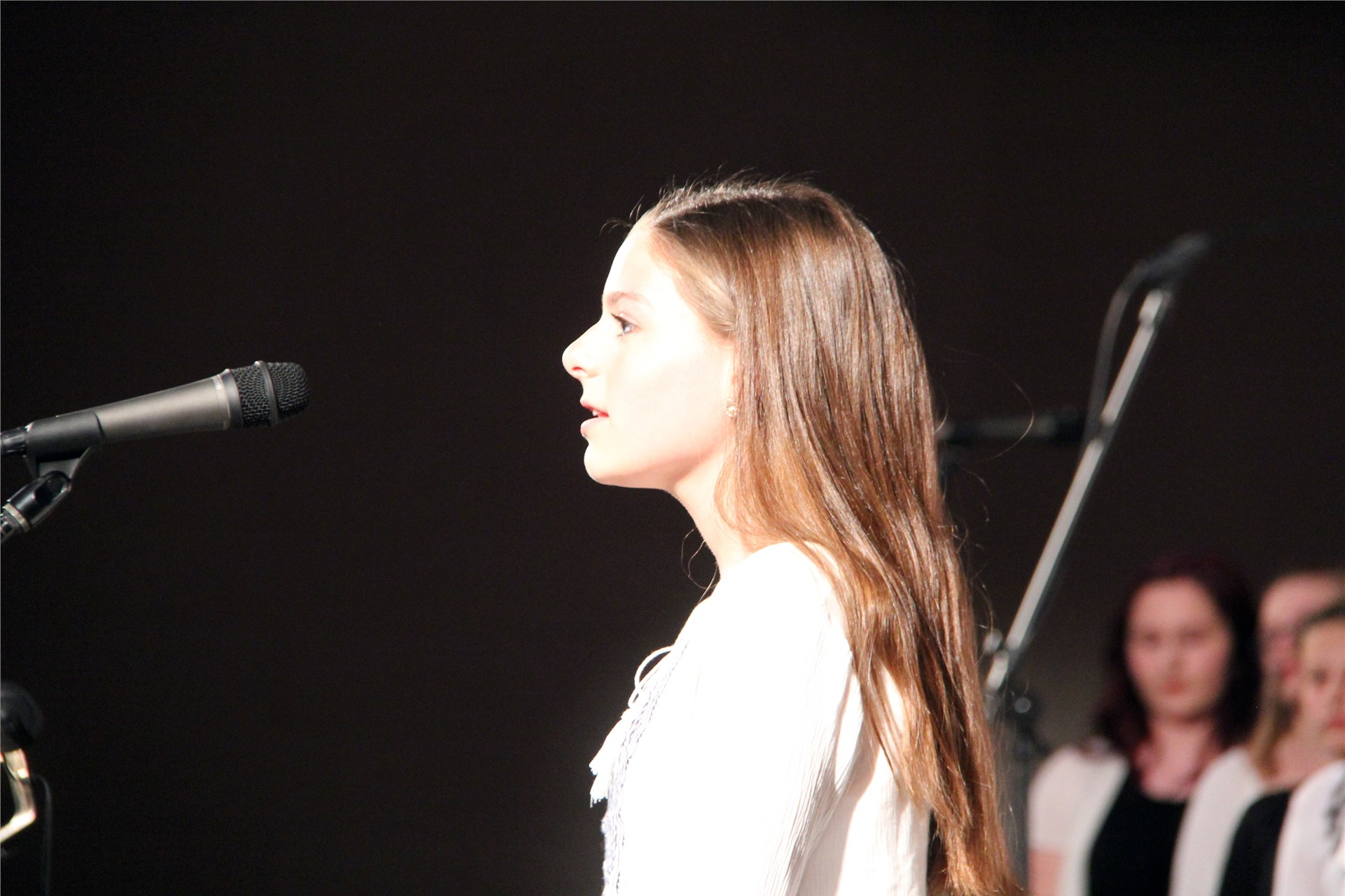 student singing at microphone