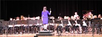 band performing with teacher conducting
