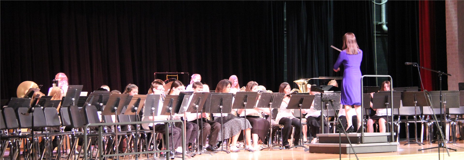 another angle of band performing with teacher conducting
