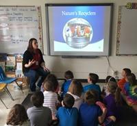 teacher talking to classroom of students