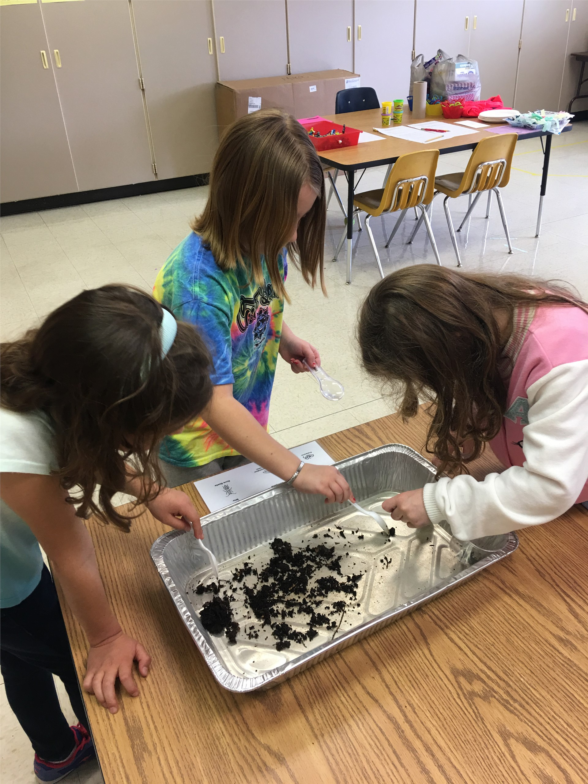 more students working with compost materials