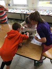 students explore compost material