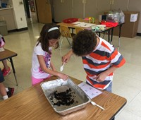 students work with compost material