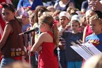 elementary-grade girl speaks at port dickinson flag day event