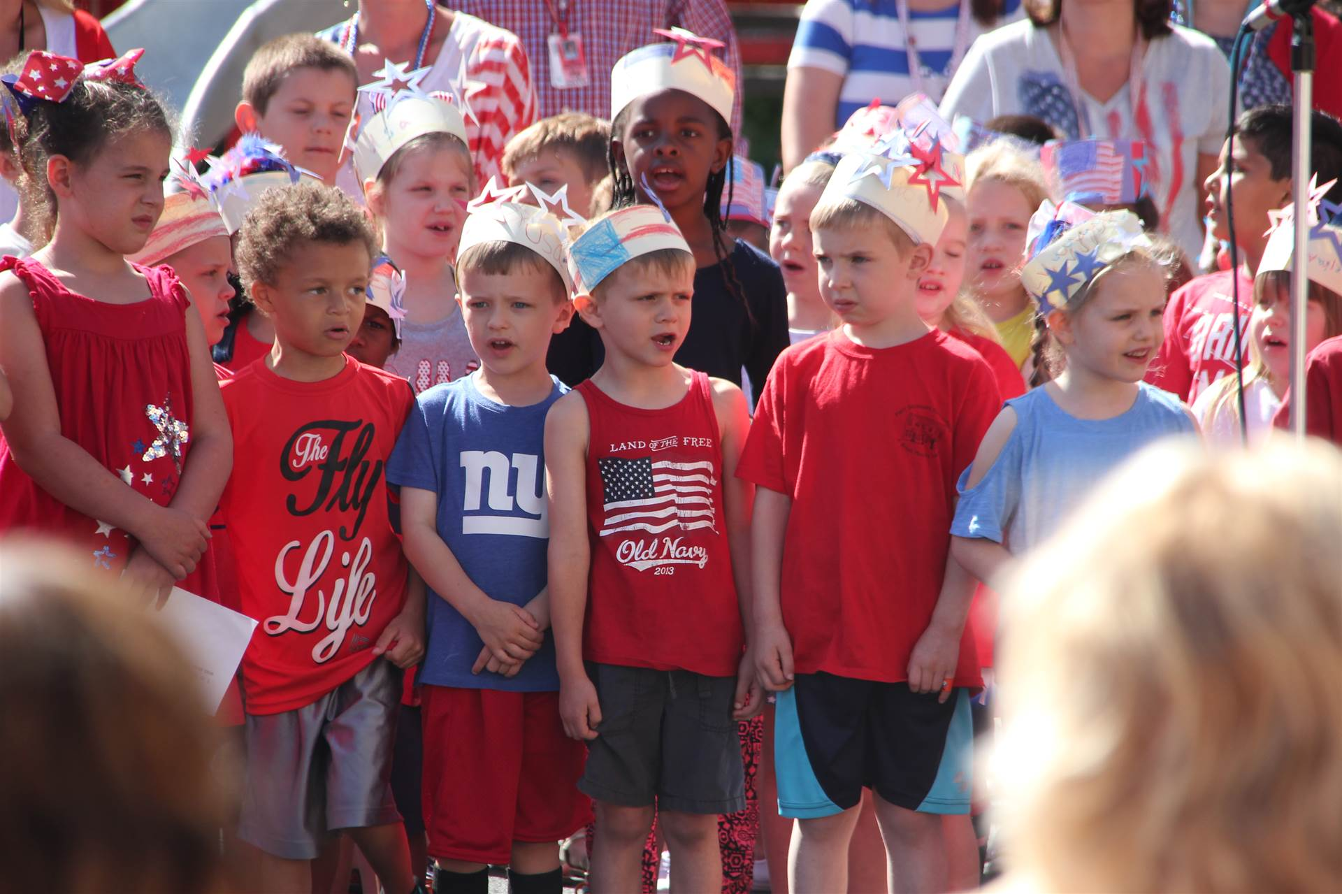 elementary students sing patriotic songs at Port Dickinson Annual Flag Day event