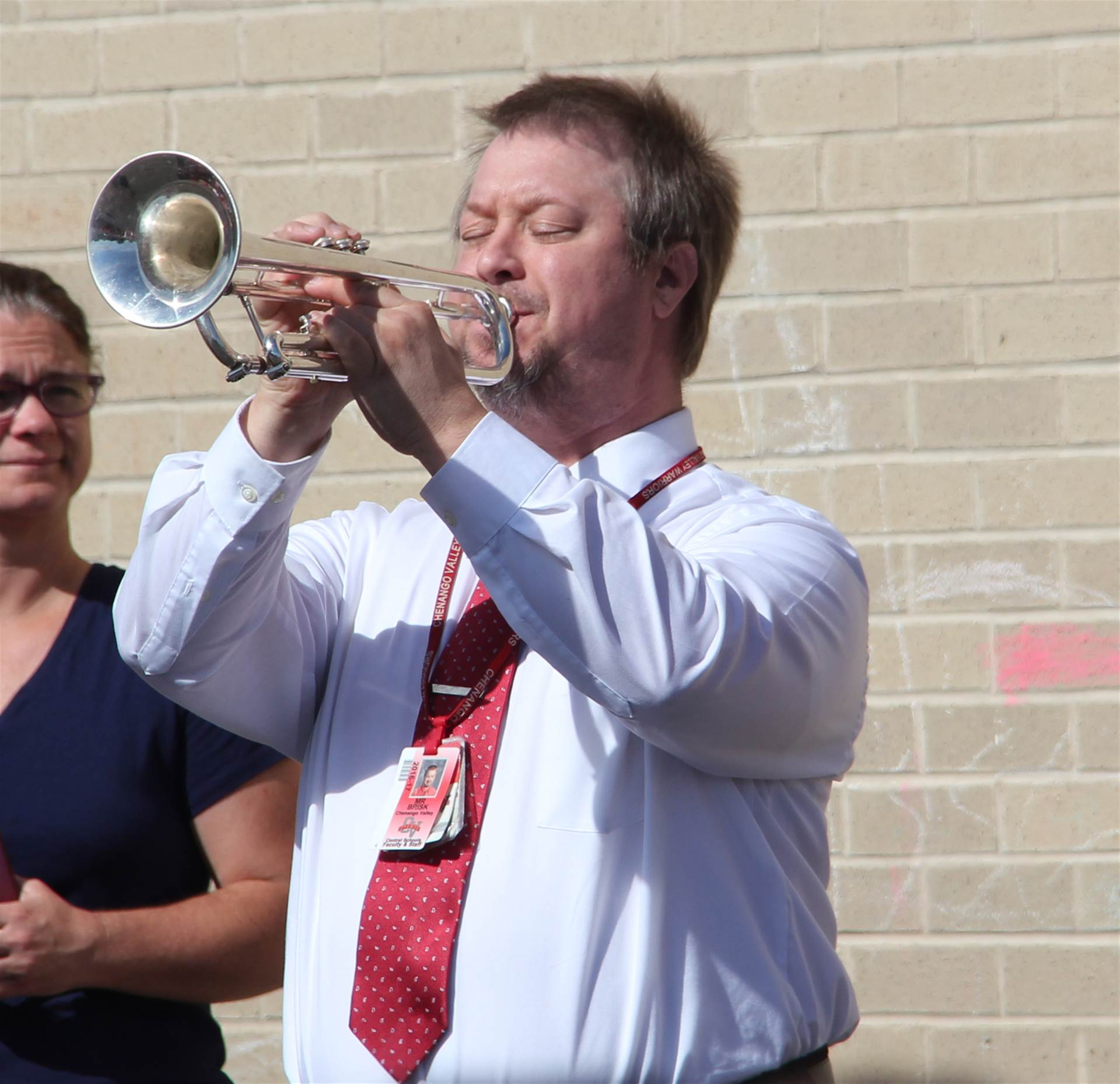 Mr. Brisk plays the trumpet at Flag Day Event