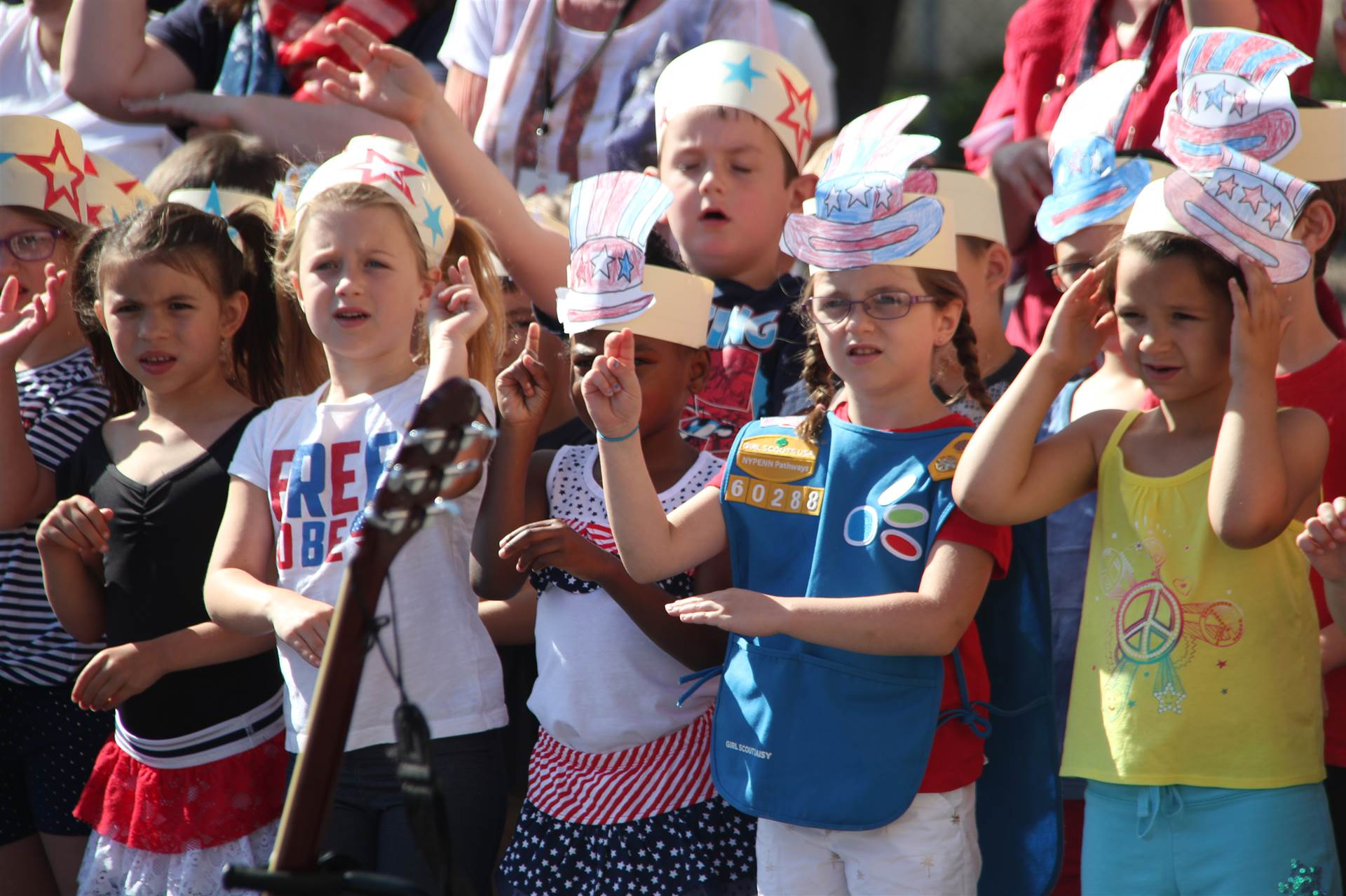 port dickinson students do sign language and sing patriotic song