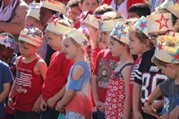 students wear patriotic paper hats at annual Port Dickinson Flag Day event