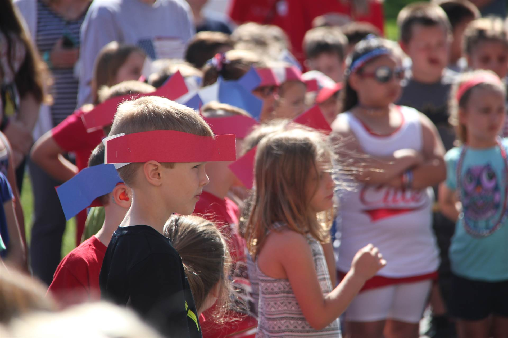 students wear patriotic paper made hats at annual port dickinson flag day event