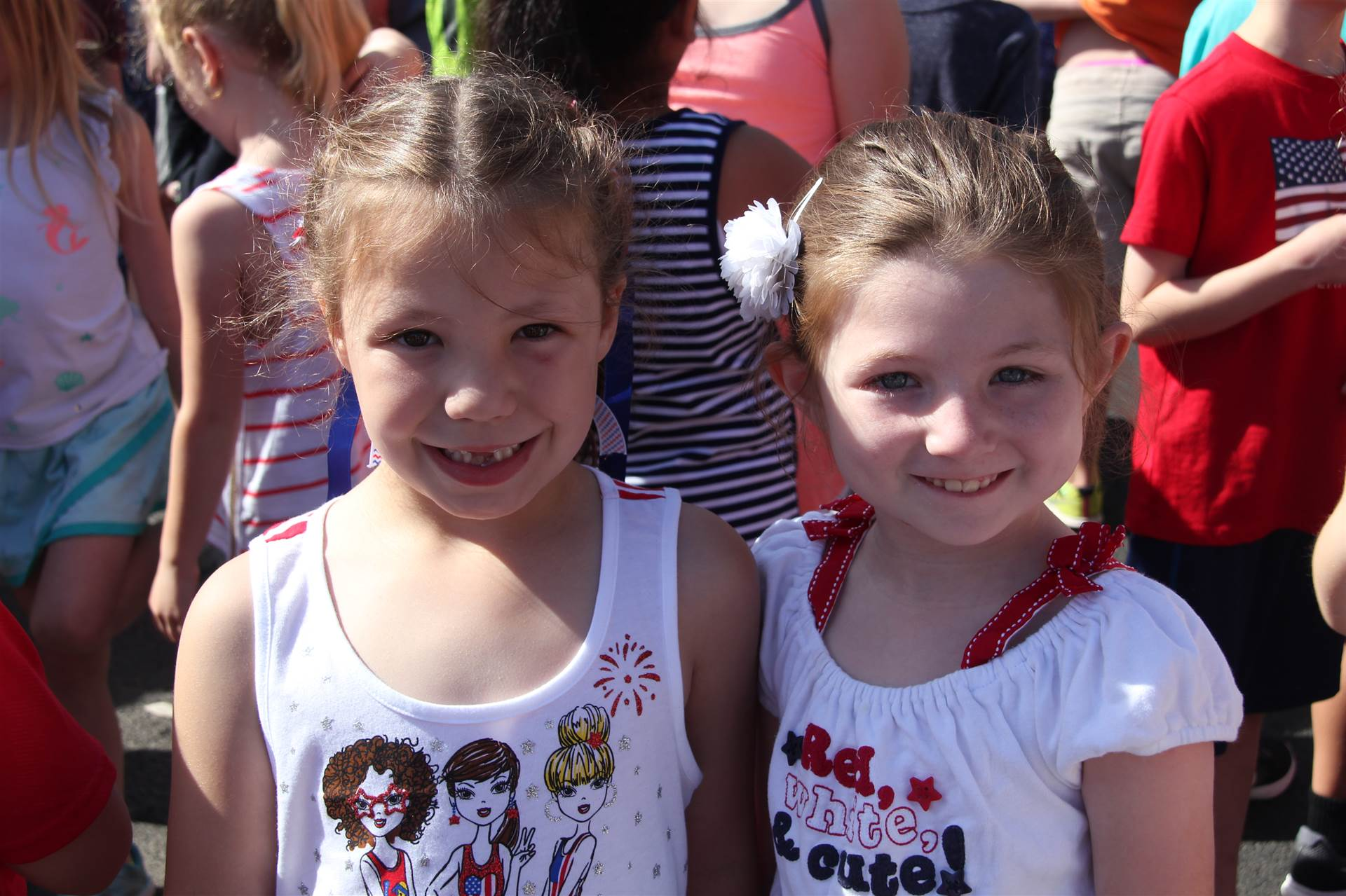two Port Dickinson Elementary students smile at annual flag day event