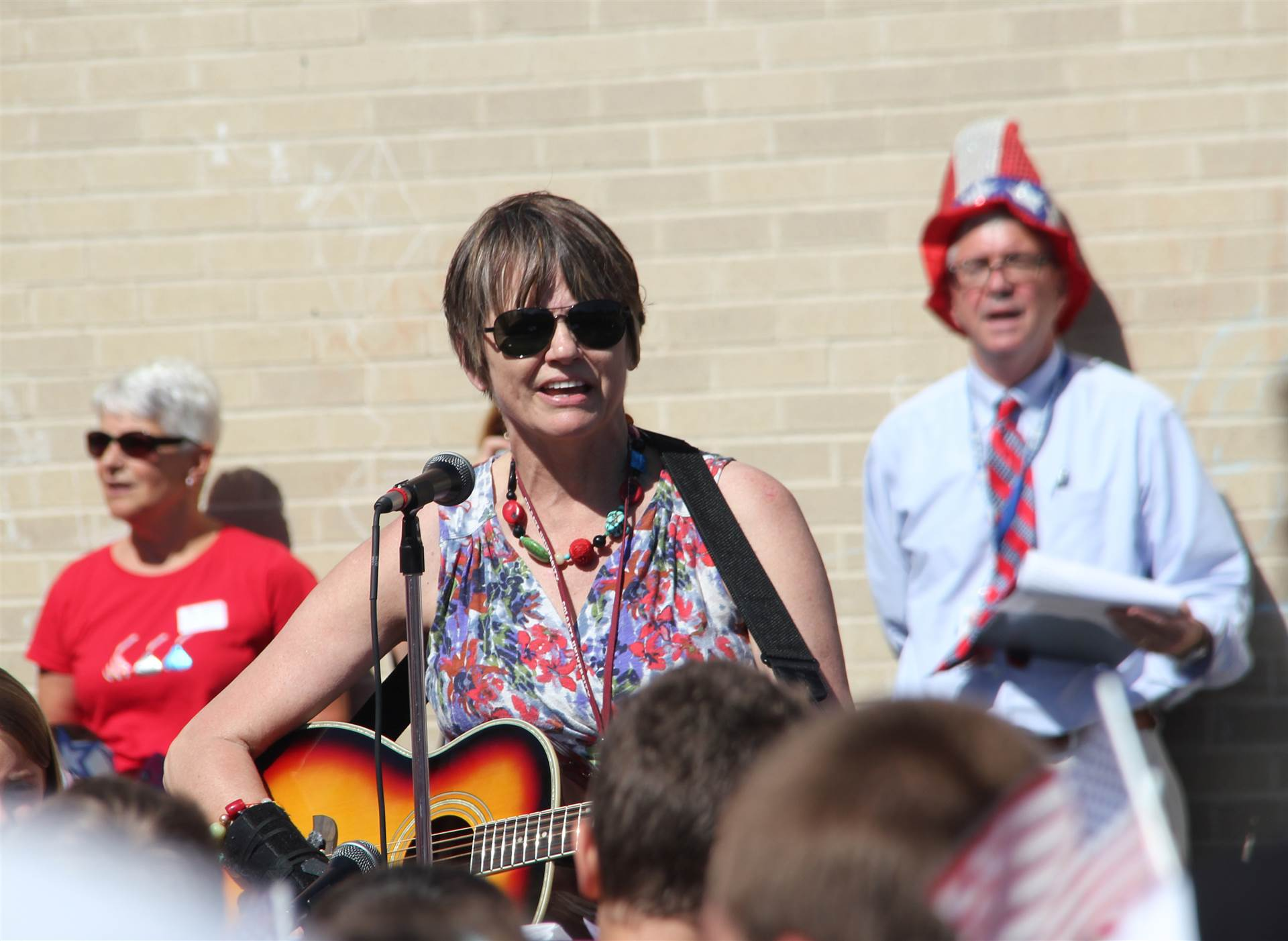 Margaret Buhl sings patriotic song at Flag Day event