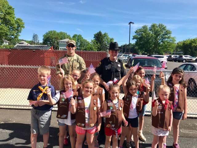U S Army Sergeant Matthew Tullis Broome County Sheriff Deputy Robert Stapleton with Girl Scout troop