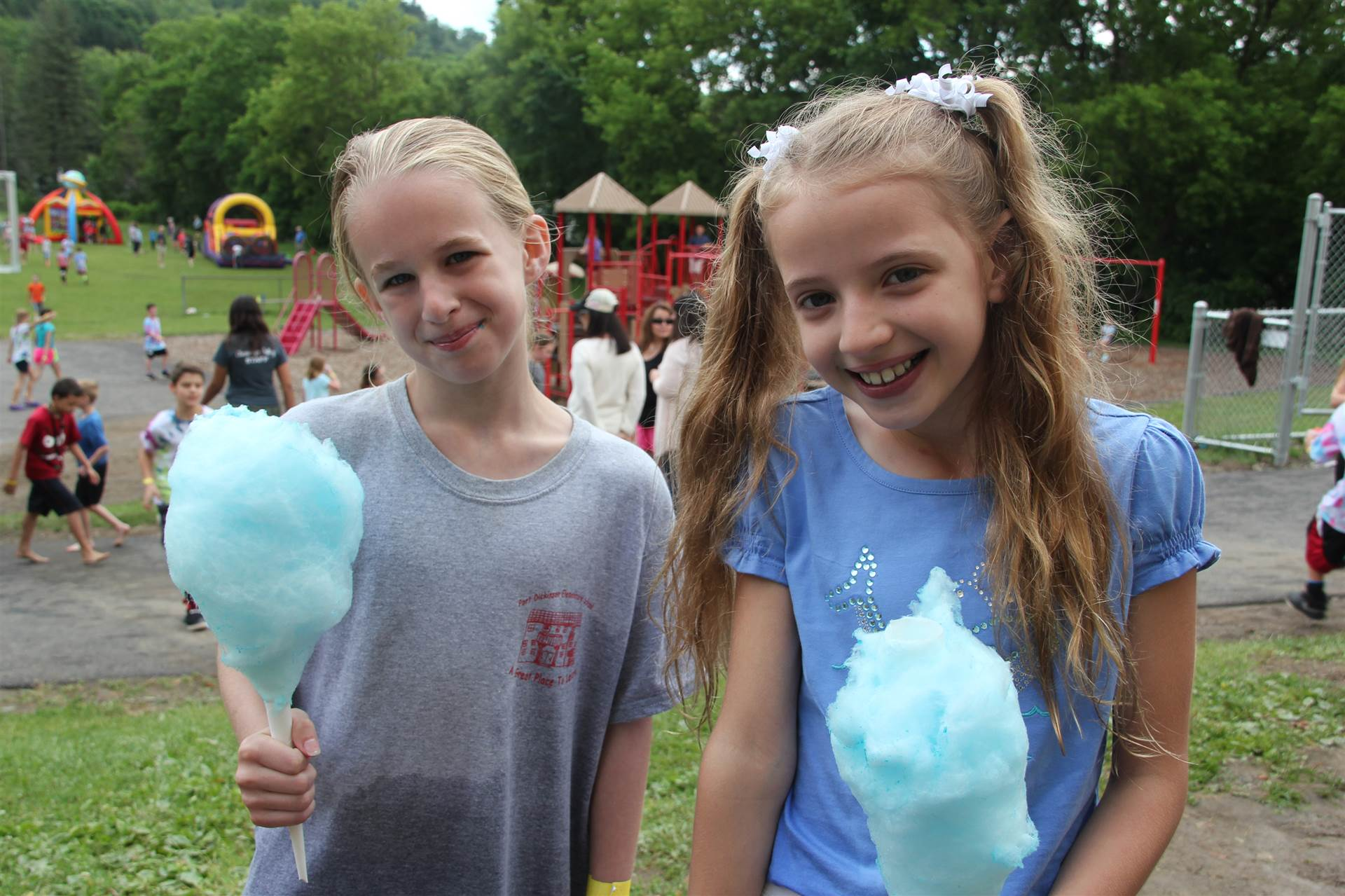 girls smile holding cotton candy