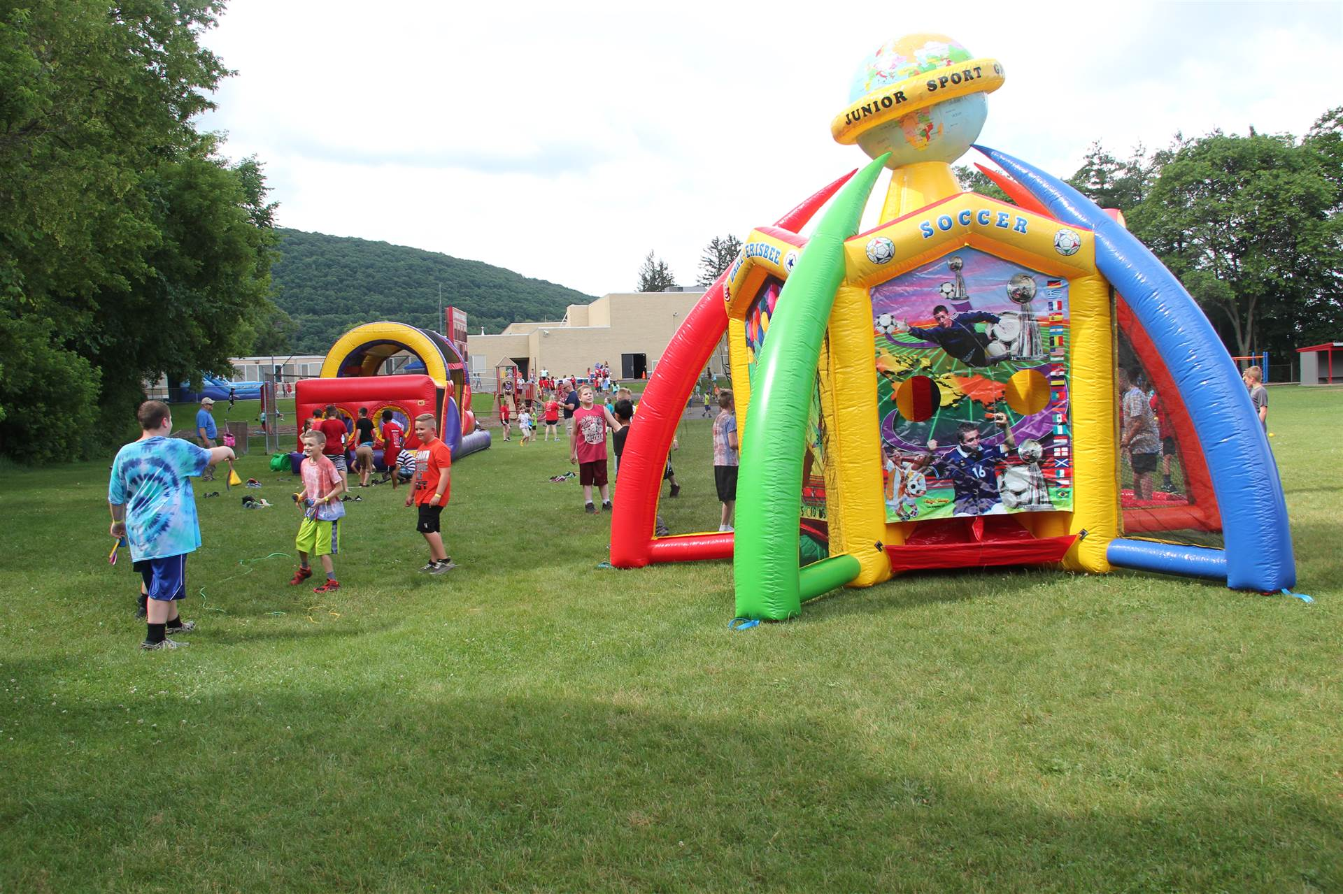 wide shot of inflatable games at carnival event