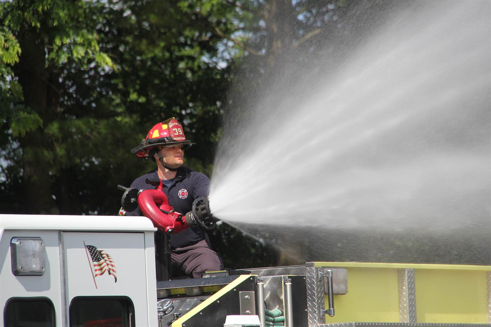 close-up of chenango bridge fire fighter spraying hose