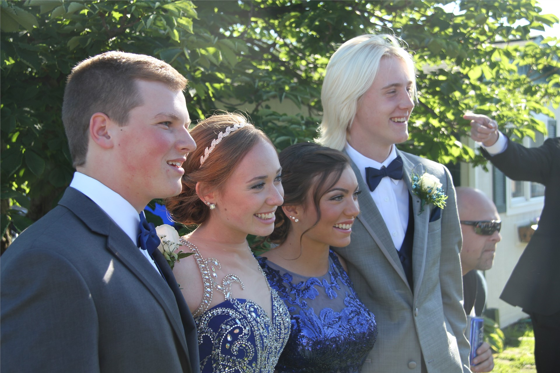Students pose for pictures before prom