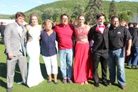 Students pose for pictures with family before prom