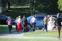 Students walking towards cars to go to prom