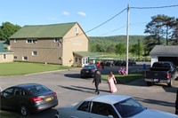 far shot of students walking towards prom event at Genegantslet Golf Course