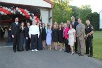 Group of chaperones pose for picture in front of prom venue