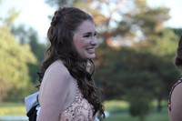 close up of girl smiling while standing in line to get into prom