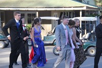 students walk towards prom venue