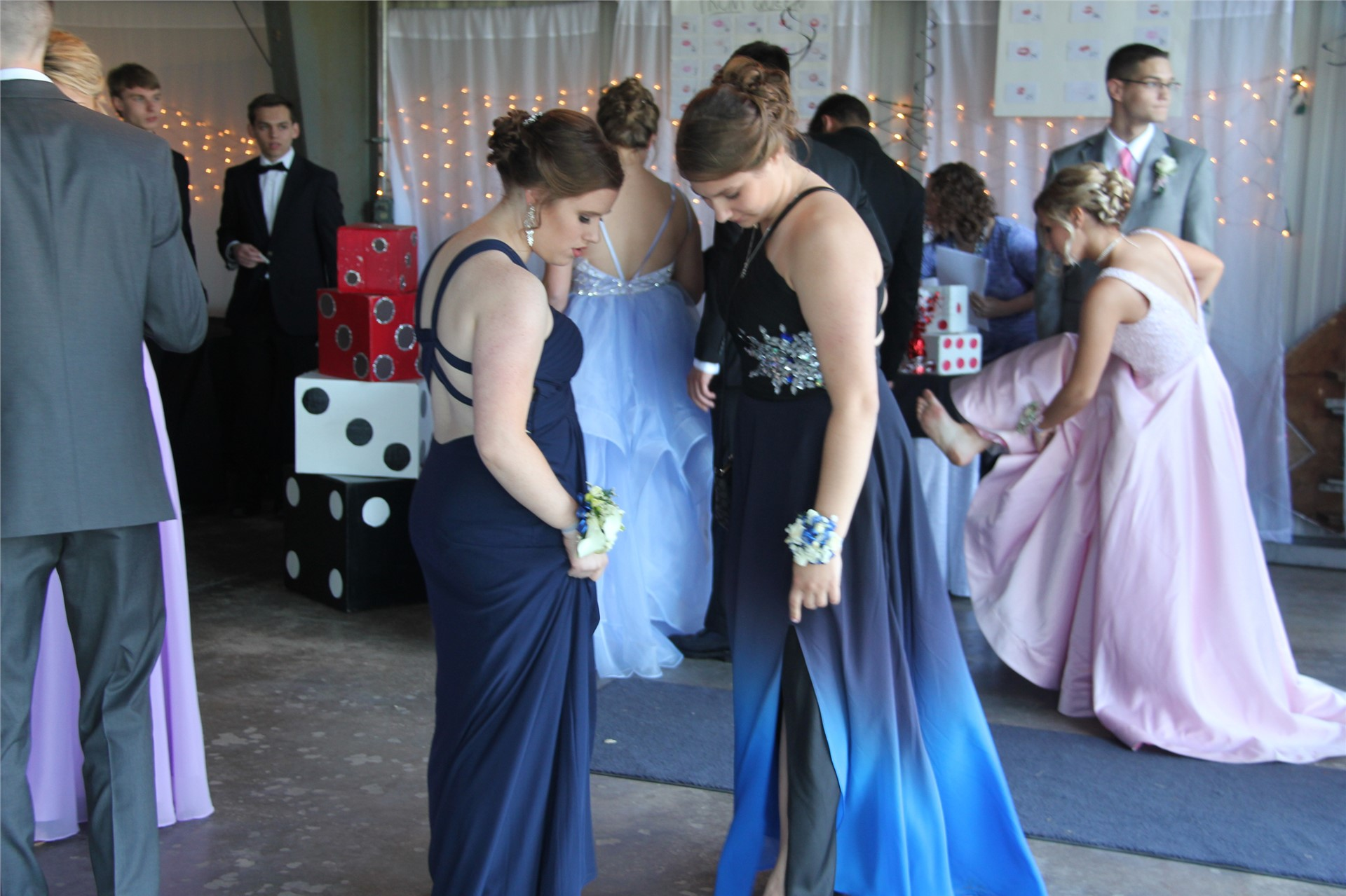 two female students talk inside of prom venue