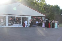 far away picture of prom venue and students standing in line to get in